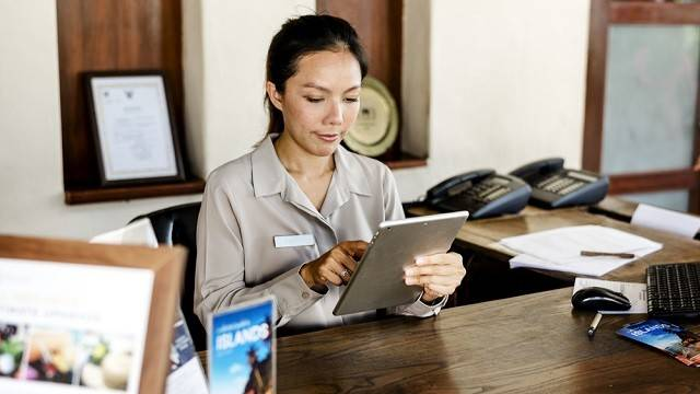 Receptionist working at the front desk